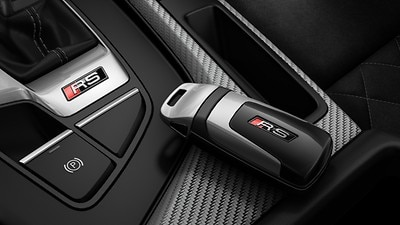 Comfort key with sensor-controlled luggage compartment release including anti-theft alarm system