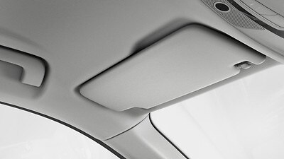 Sun visor on driver and front passenger side, retractable