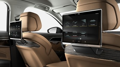 Rear seat entertainment system including two Audi tablets