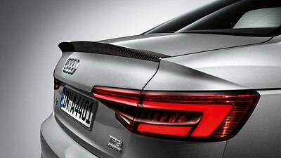 Carbon spoiler on luggage compartment lid