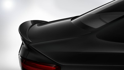 Body-colored, trunk-mounted rear lip spoiler