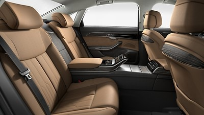 Rear seat package, individual seats with continuous leather-covered center console