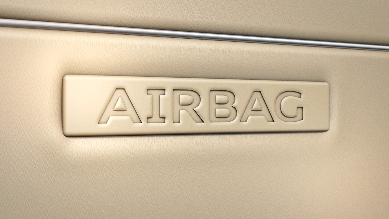 Rear side airbags and illuminated seat belt buckles