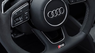 Three-spoke multifunction flat-bottom sport steering wheel with RS badging and shift paddles