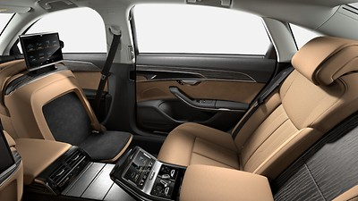 Rear seat package, reclining seat with continuous leather-covered center console